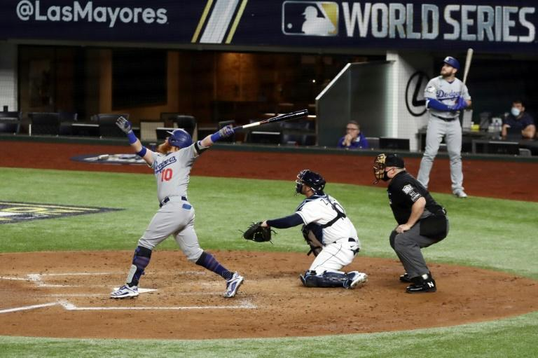 Los Angeles batter Justin Turner belts a double against the Tampa Bay Rays during the third inning in game three of the World Series in Texas