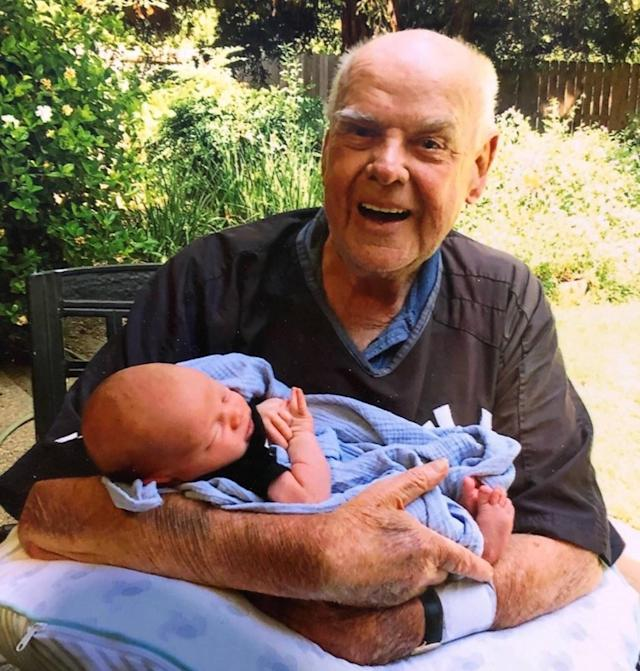 """<div class=""""caption""""> Galvin holding his first great-grandchild. </div> <cite class=""""credit"""">Courtesy of Tammy Galvin</cite>"""