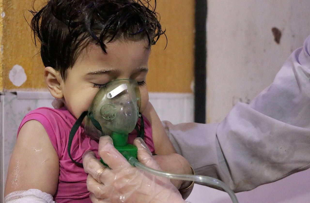<p>An affected Syrian kid receives medical treatment after Assad regime forces allegedly conducted poisonous gas attack to Douma town of Eastern Ghouta in Damascus, Syria on April 8, 2018. (Photo: Mouneb Taim/Anadolu Agency/Getty Images) </p>