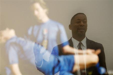 """Curator Franklin Sirmans is reflected in """"Pieta"""" by Generic Art Solutions during construction of the exhibition, """"Futbol: The Beautiful Game"""", at the Los Angeles County Museum of Art (LACMA) in Los Angeles, California, January 27, 2014. REUTERS/David McNew"""