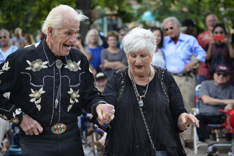SANTA FE, NEW MEXICO - JULY 11, 2018: A couple dressed in western clothing and accessories dance to live music on the historic Plaza in Santa Fe, New Mexico. (Photo by Robert Alexander/Getty Images)