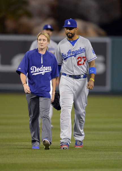 CORRECTS ID OF TRAINER TO ASSISTANT ATHLETIC TRAINER NANCY PATTERSON INSTEAD OF SUE FALSONE - Los Angeles Dodgers center fielder Matt Kemp, right, walks off the field with assistant athletic trainer Nancy Patterson during the seventh inning of their baseball game against the Los Angeles Angels, Wednesday, May 29, 2013, in Anaheim, Calif. The Angels won 4-3. (AP Photo/Mark J. Terrill)