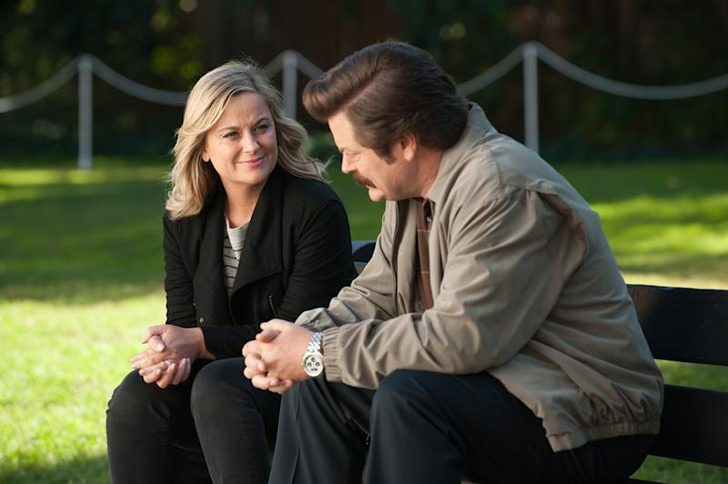 "PARKS AND RECREATION -- ""One Last Ride"" Episode 712/713 -- Pictured: (l-r) Amy Poehler as Leslie Knope, Nick Offerman as Ron Swanson -- (Photo by: Colleen Hayes/NBCU Photo Bank/NBCUniversal via Getty Images via Getty Images)"