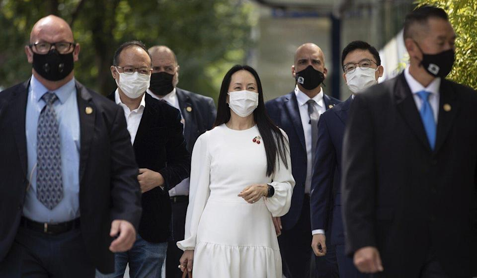 Meng Wanzhou, surrounded by security personnel, returns to court after a break in her extradition hearing in Vancouver, British Columbia, on Tuesday. Photo: AP