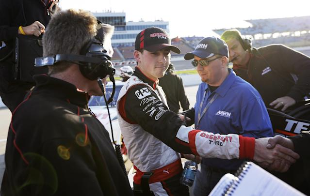 Ryan Blaney, center, celebrates with crew members after qualifying for the NASCAR Nationwide series auto race, Saturday, May 17, 2014, at Iowa Speedway in Newton, Iowa. Blaney won the pole position for Sunday's race. (AP Photo/Charlie Neibergall)