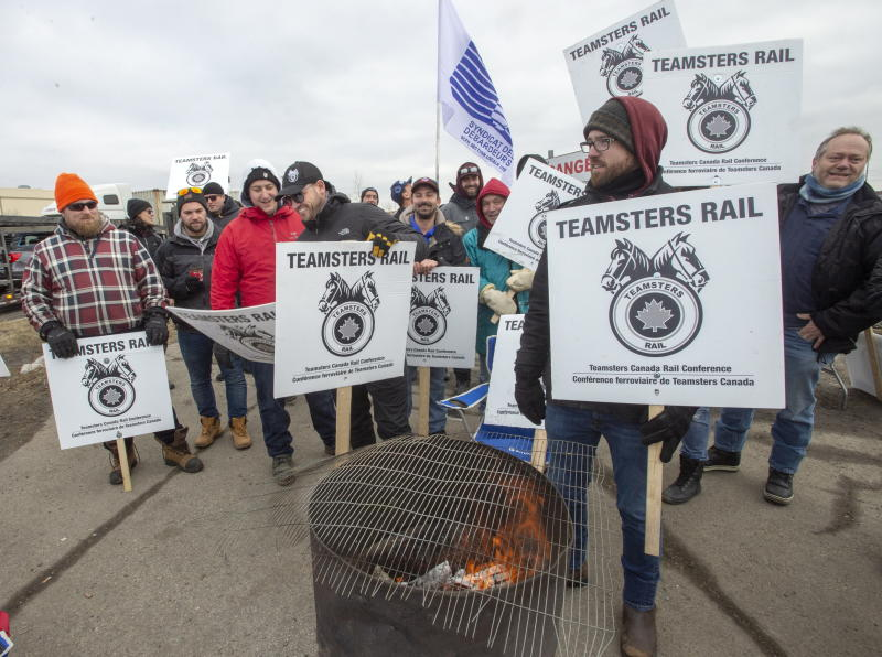 Striking Canadian National Railway workers picket in front of the company's Taschereau railyard Monday, November 25, 2019 in Montreal. (Ryan Remiorz/The Canadian Press via AP)