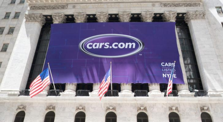 a large banner advertising cars.com, representing cheap stocks