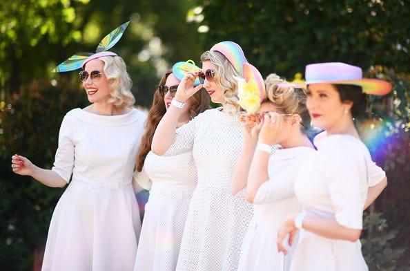 Racegoers pose for a photo on Day Two of the Royal Ascot Meeting at Ascot Racecourse.