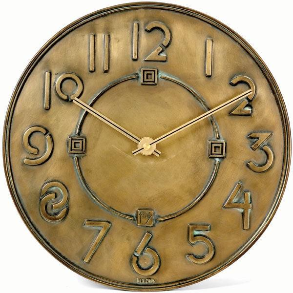 """Bulova and the Frank Lloyd Wright Foundation joined forces to create the Exhibition Typeface wall clock with distinct, large numbers. Made of cast resin with antiqued-bronze metallic finish, the clock measures 12 inches in diameter. $63, Amazon. <a href=""""https://www.amazon.com/Bulova-Exhibition-Typeface-Antique-Metallic/dp/B001VJ64KY"""" rel=""""nofollow noopener"""" target=""""_blank"""" data-ylk=""""slk:Get it now!"""" class=""""link rapid-noclick-resp"""">Get it now!</a>"""