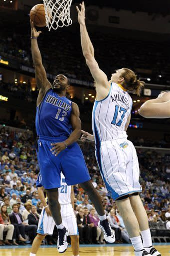 Dallas Mavericks guard Mike James (13) drives to the basket against New Orleans Hornets forward Lou Amundson (17) during the first half of an NBA basketball game in New Orleans, Sunday, April 14, 2013. (AP Photo/Jonathan Bachman)