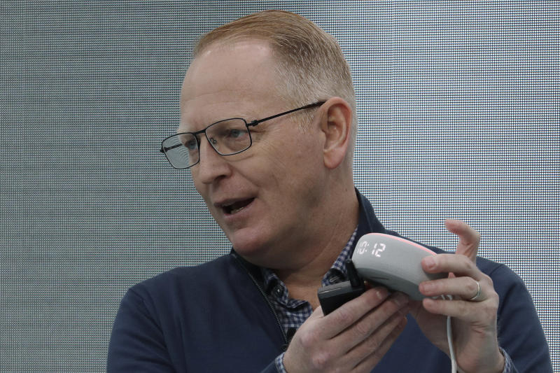 Dave Limp, senior vice president for Amazon devices & services, holds a new Echo Dot with Clock device as he speaks Wednesday, Sept. 25, 2019, at an event in Seattle to unveil new products that work with the company's Alexa smart devices line. (AP Photo/Ted S. Warren)