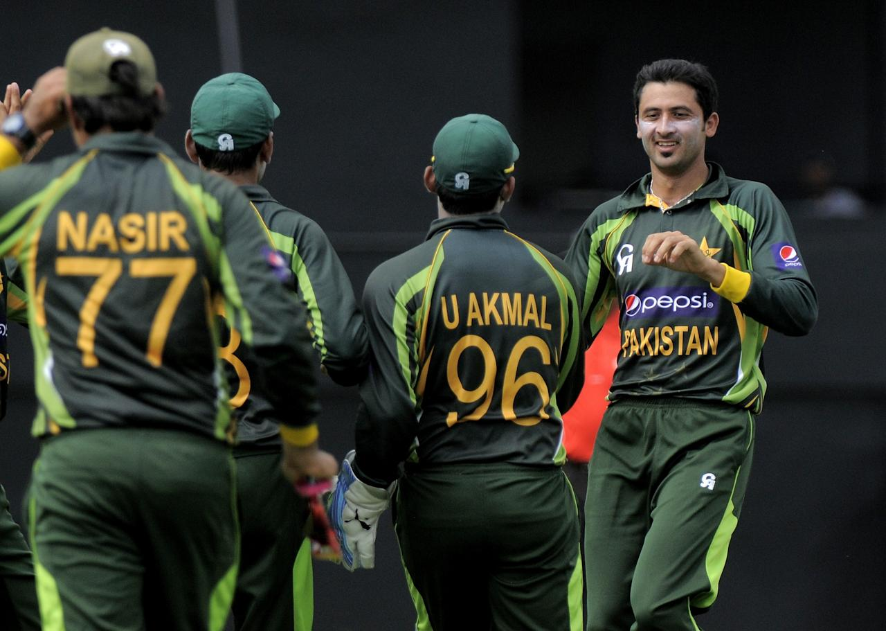 Pakistan bowler Junaid Khan celebrates the dismissal of West Indies batsman Devon Smith caught by Mohammad Hafeez for 7 runs during the 5th and final ODI West Indies v Pakistan on July 24, 2013 at Beausejour Cricket Ground, in Gros Islet, St. Lucia. AFP PHOTO/RANDY BROOKS        (Photo credit should read RANDY BROOKS/AFP/Getty Images)