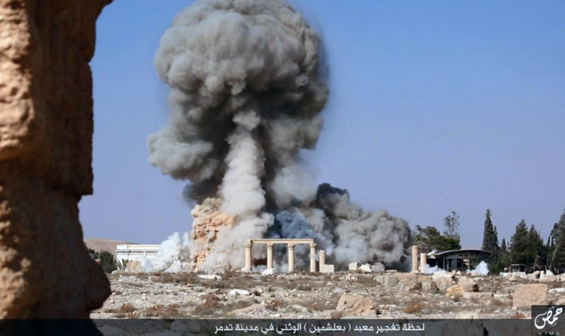 FILE - This undated photo released Tuesday, Aug. 25, 2015, file photo, on a social media site used by Islamic State militants, which has been verified and is consistent with other AP reporting, shows smoke from the detonation of the 2,000-year-old temple of Baalshamin in Syria's ancient caravan city of Palmyra. (Islamic State social media account via AP, File)