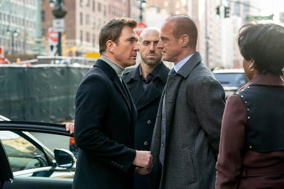 """Detective Elliot Stabler (Christopher Meloni), second from right, faces off against criminal pharmaceutical executive Richard Wheatley (Dylan McDermott), left, in NBC's """"Law & Order: Organized Crime."""""""