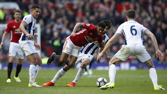 <p>West Bromwich Albion's Claudio Yacob, Jake Livermore and Jonny Evans in action with Manchester United's Marcus Rashford </p>