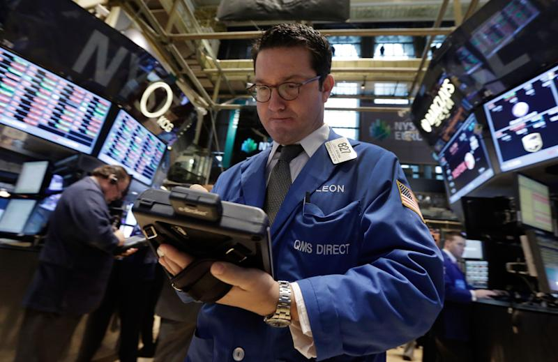 Trader Leon Montana works on the floor of the New York Stock Exchange, Thursday, Dec. 19, 2013. Stocks edged lower in early trading Thursday, pulling back from record levels. (AP Photo/Richard Drew)