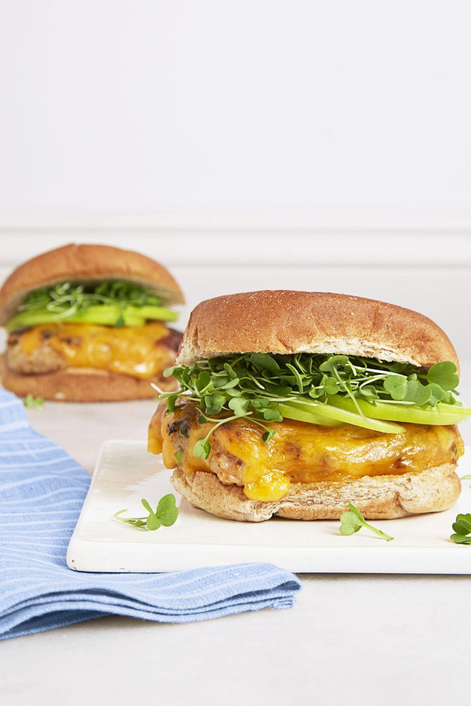 """<p>We packed these chicken patties with smoky barbecue sauce and green onions, then topped 'em with sharp Cheddar, sweet apples and sprouts. Trust us, nobody will miss the beef.</p><p><a href=""""https://www.goodhousekeeping.com/food-recipes/a37552/bbq-chicken-cheddar-burgers-recipe/"""" rel=""""nofollow noopener"""" target=""""_blank"""" data-ylk=""""slk:Get the recipe for BBQ Chicken & Cheddar Burgers »"""" class=""""link rapid-noclick-resp""""><em>Get the recipe for BBQ Chicken & Cheddar Burgers »</em></a></p>"""