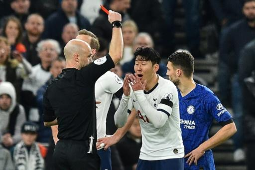 Son Heung-min is shown the red card after he kicked out at Antonio Rudiger