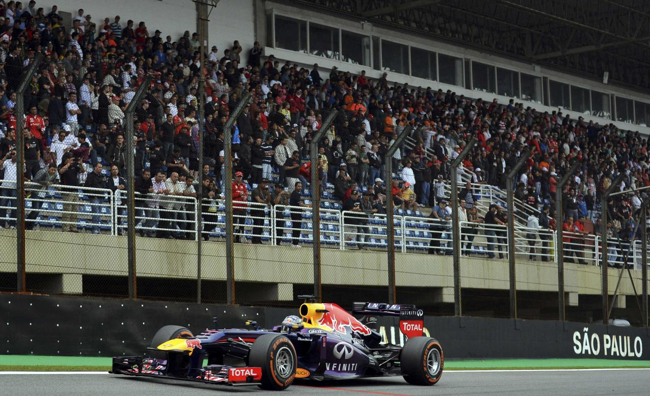 Red Bull Formula One driver Sebastian Vettel of Germany drives during the Brazilian F1 Grand Prix at the Interlagos circuit in Sao Paulo November 24, 2013. REUTERS/Nelson Almeida/Pool (BRAZIL - Tags: SPORT MOTORSPORT F1)