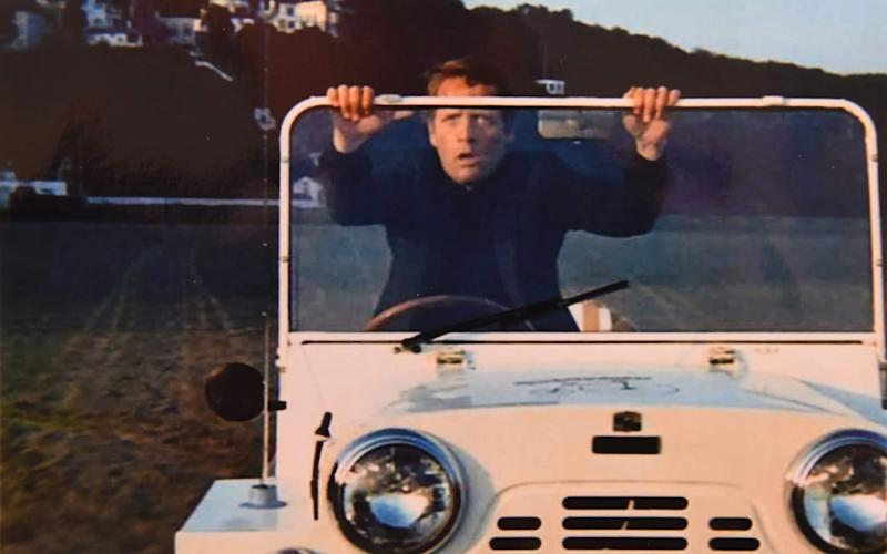 Patrick McGoohan, who starred as 'Number Six' in The Prisoner, with the 1965 Austin Mini Moke used in the cult TV series and which now has been restored - COPYRIGHT JAY WILLIAMS
