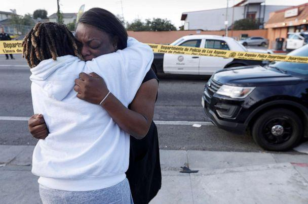 PHOTO: 'I'm telling you, that was my friend. My friend's dead. He was my childhood friend,' said Marquesa Lawson, 34, left, over the shooting of rapper Nipsey Hussle who was killed in a shooting outside his store, March 31, 2019 in Los Angeles. (Genaro Molina/Los Angeles Times via Getty Images)