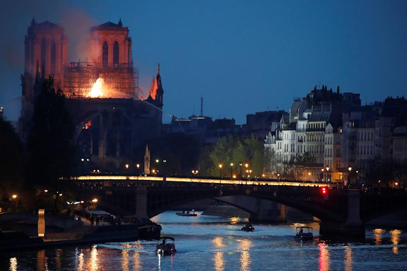Smoke rises from the burning roof at the Notre-Dame Cathedral after a fire broke out, in Paris, France April 15, 2019. Picture taken April 15, 2019. REUTERS/Charles Platiau
