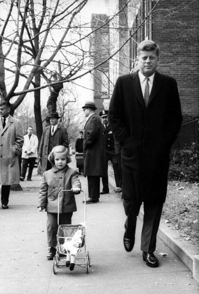 <p>President-elect Kennedy on a stroll with his daughter Caroline. </p>