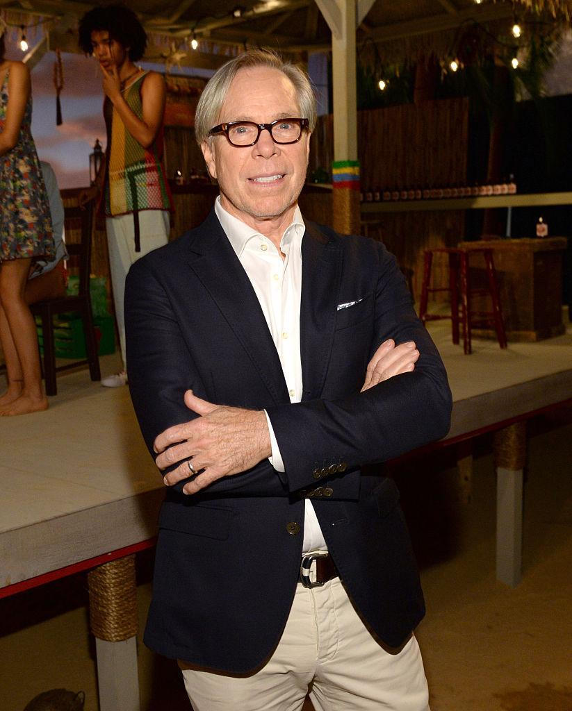 Tommy Hilfiger dons his signature look. (Photo: Getty)