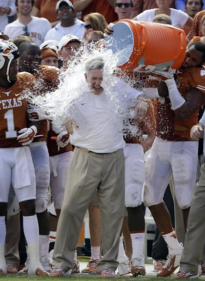 Mack Brown and the Longhorns had a win over Oklahoma to celebrate for the first time in four years. (AP)