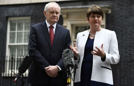 Arlene Foster (R) and Martin McGuinness, First and Deputy First Ministers of Northern Ireland, speak to journalists as they leave Number 10 Downing Street in London, Britain October 24, 2016. REUTERS/Dylan Martinez