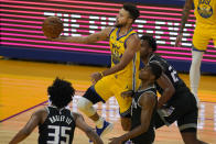 Golden State Warriors guard Stephen Curry, center, shoots against the Sacramento Kings during the first half of an NBA basketball game in San Francisco, Monday, Jan. 4, 2021. (AP Photo/Jeff Chiu)