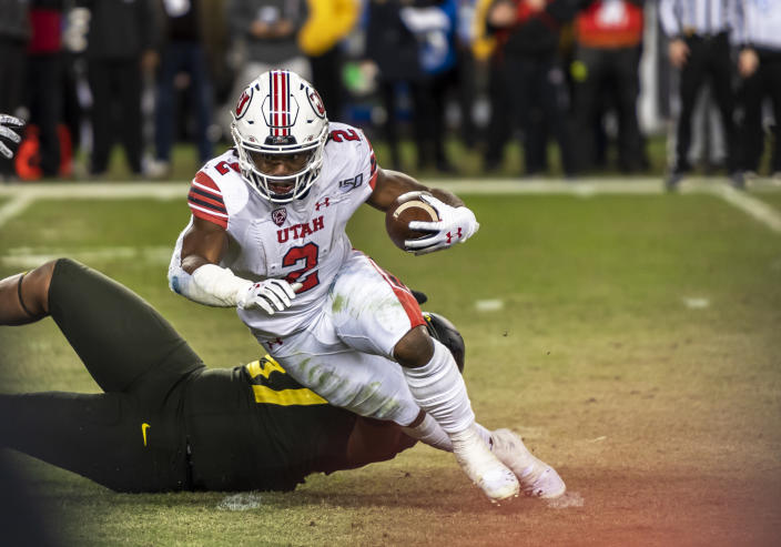 Utah RB Zack Moss has outstanding run skills but also a long injury history. (Photo by Douglas Stringer/Icon Sportswire via Getty Images)