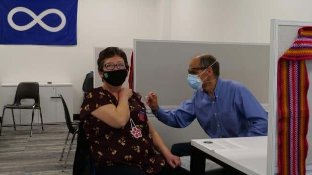 Verna McCallum receives her COVID-19 vaccination at a MN-S pop-up clinic on Friday, April 23, 2021. (Submitted by Métis Nation-Saskatchewan - image credit)