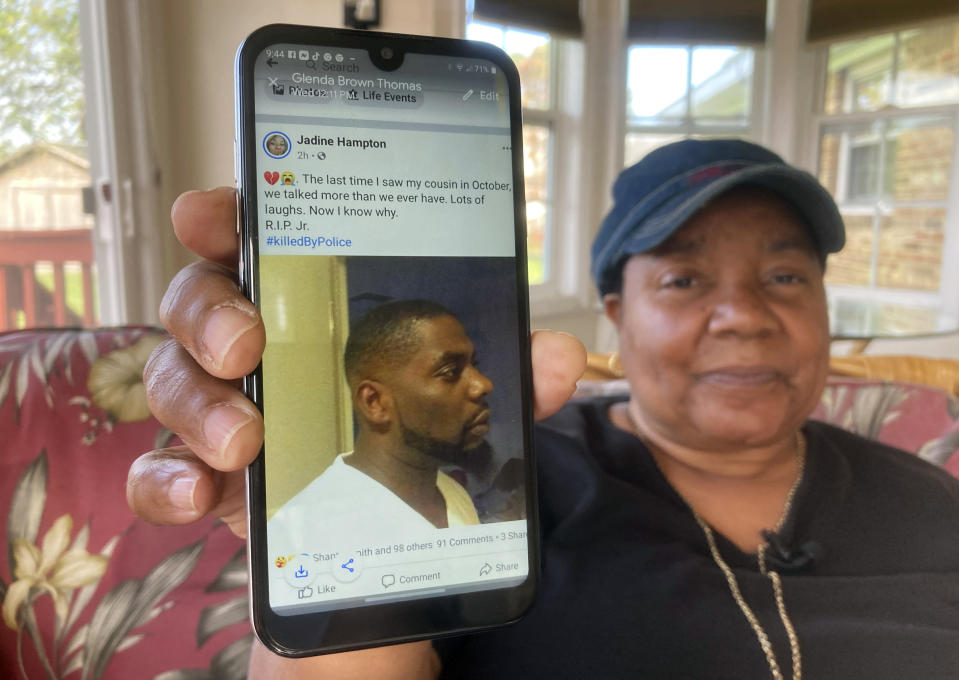 Glenda Brown Thomas displays a photo of her nephew, Andrew Brown Jr., on her cell phone at her home in Elizabeth City, N.C., on Thursday, April 22, 2021. Brown was shot and killed Wednesday by a sheriff's deputy, who was attempting to execute a warrant. (AP Photo/Allen G. Breed)