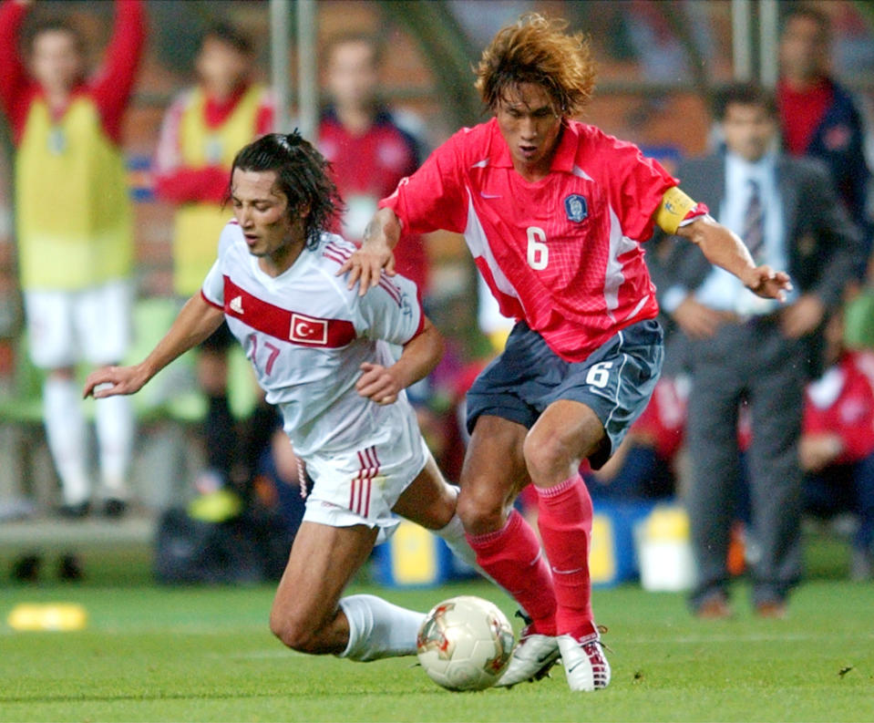 FILE - In this June 29, 2002, file photo, South Korea's Yoo Sang-chul, right, competes for the ball with Turkey's Ilhan Mansiz during the 2002 World Cup third place playoff soccer match between South Korea and Turkey, at the Daegu World Cup stadium, in Daegu, South Korea. Yoo, one of the stars of South Korea's surprising run to the semifinals at the 2002 World Cup, has died after long battle with pancreatic cancer. He was 49. (AP Photo/Tony Gutierrez,File)
