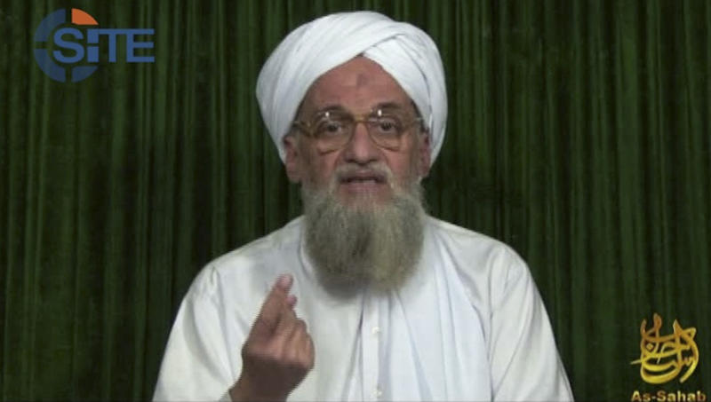 FILE - This image from video AP obtained Sunday, Feb. 12, 2012, from the SITE Intel Group, an American private terrorist threat analysis company, has been authenticated based on details in it, shows al-Qaida's leader Ayman al-Zawahri in a web posting by al-Qaida's media arm, as-Sahab, calling on Muslims across the Arab world and beyond to support rebels in Syria who are seeking to overthrow President Bashar Assad. In an audio message released by As-Sahab and posted on militant websites early Saturday, October 12, 2012,  al-Zawahri claimed Washington allowed the  production of a film that insulted Islam's Prophet Muhammad under the pretext of freedom of expression, and urged Muslims to wage holy war against the United States and Israel. (AP Photo/SITE Intel Group, File)