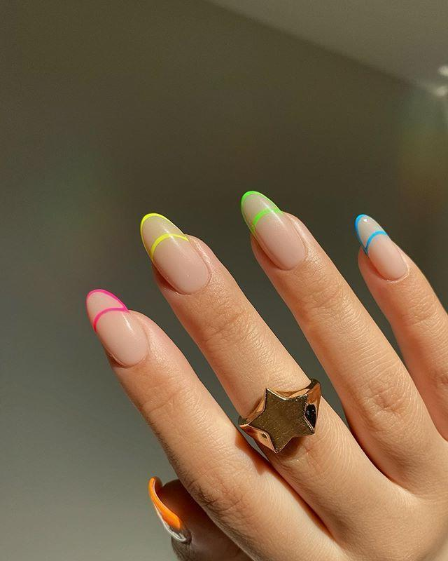 """<p>Want to try neon tips but don't want a big pop of color? Try tracing the outline of a French manicure with super thin lines for a clean, minimalist look. </p><p><a class=""""link rapid-noclick-resp"""" href=""""https://go.redirectingat.com?id=74968X1596630&url=https%3A%2F%2Fwww.sephora.com%2Fproduct%2Fnails-inc-naked-in-neon-nail-polish-set-P457823%3FskuId%3D2345759%26icid2%3Dproducts%2Bgrid%253Ap457823%253Aproduct&sref=https%3A%2F%2Fwww.goodhousekeeping.com%2Fbeauty%2Fnails%2Fg1267%2Ffrench-manicure-ideas%2F"""" rel=""""nofollow noopener"""" target=""""_blank"""" data-ylk=""""slk:SHOP NEON POLISH"""">SHOP NEON POLISH</a></p><p><a href=""""https://www.instagram.com/p/CBqsRu5Dja2/&hidecaption=true"""" rel=""""nofollow noopener"""" target=""""_blank"""" data-ylk=""""slk:See the original post on Instagram"""" class=""""link rapid-noclick-resp"""">See the original post on Instagram</a></p>"""