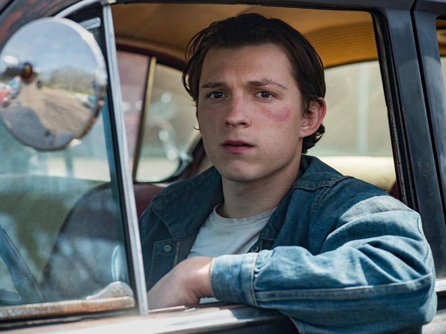 Tom Holland works to shed his trademark earnestness in Netflix's unsettling 'The Devil All the Time' (Netflix)