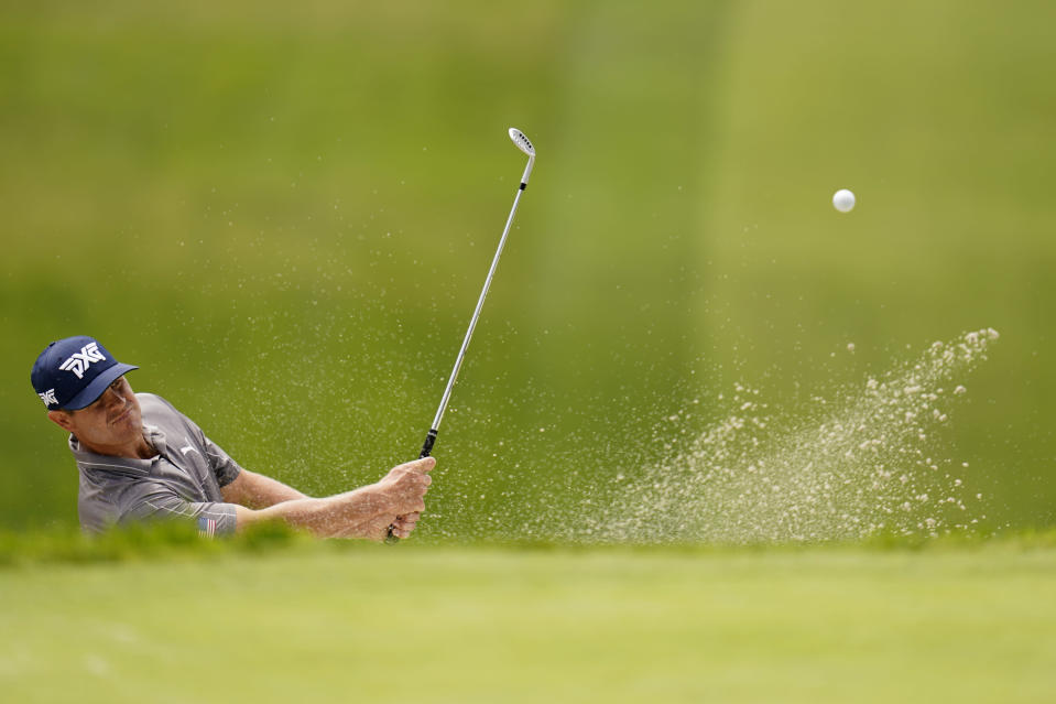 Kyle Westmoreland hits out of a bunker on the 13th hole during a practice round of the U.S. Open Golf Championship, Monday, June 14, 2021, at Torrey Pines Golf Course in San Diego. (AP Photo/Gregory Bull)