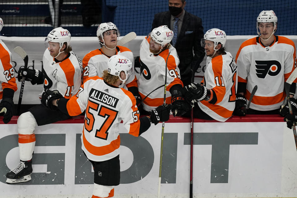 Philadelphia Flyers right wing Wade Allison (57) celebrates his goal with his teammates during the second period of an NHL hockey game against the Washington Capitals, Friday, May 7, 2021, in Washington. (AP Photo/Alex Brandon)