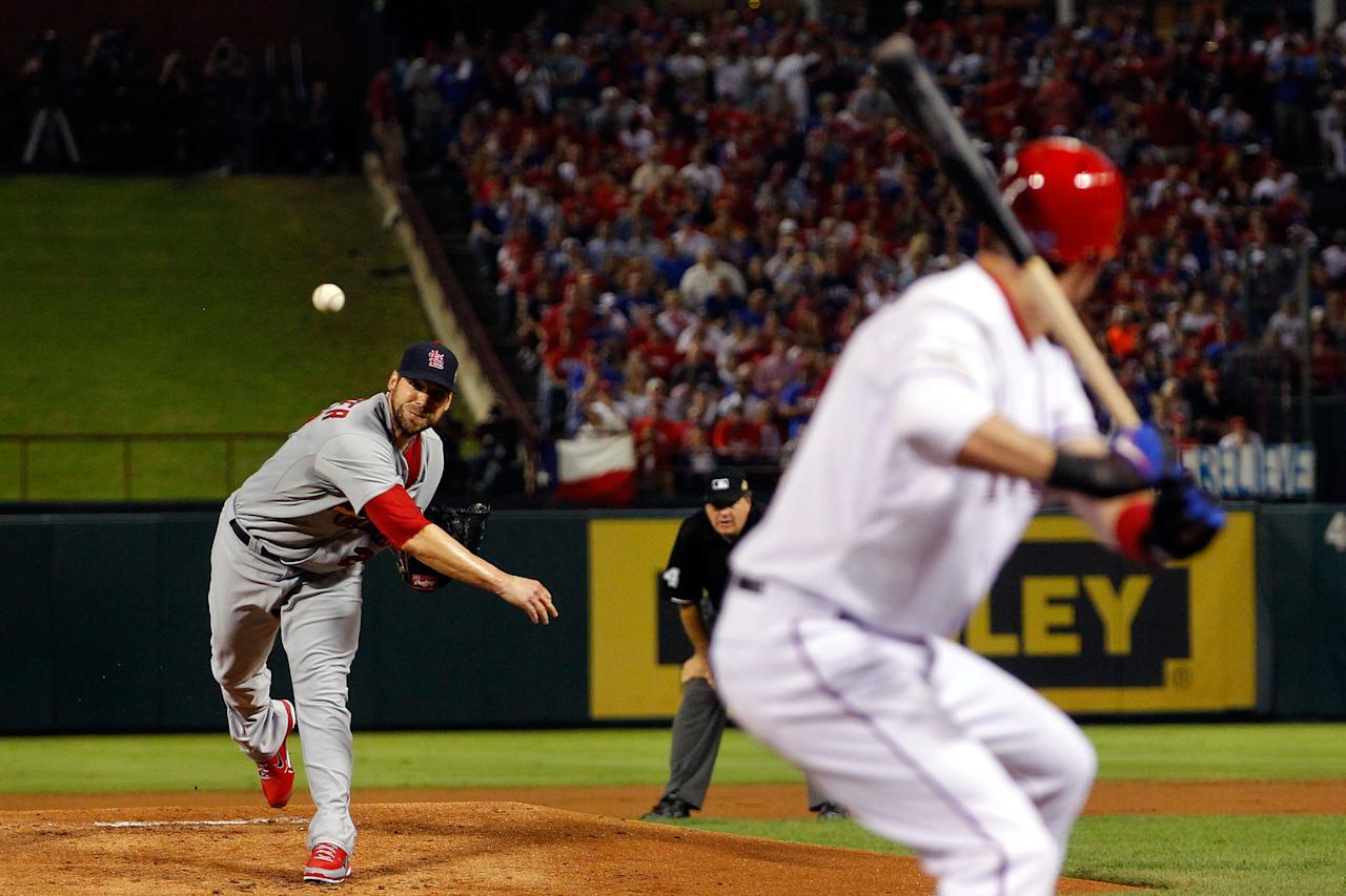 ARLINGTON, TX - OCTOBER 24:  Chris Carpenter #29 of the St. Louis Cardinals pitches in the second inning during Game Five of the MLB World Series against the Texas Rangers at Rangers Ballpark in Arlington on October 24, 2011 in Arlington, Texas.  (Photo by Mike Segar-Pool/Getty Images)