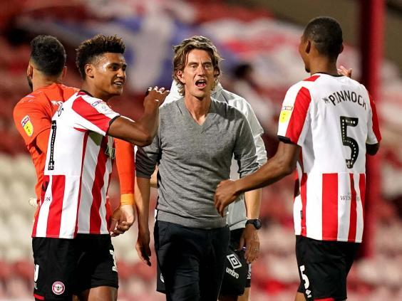 Brentford manager Thomas Frank celebrates victory (PA)
