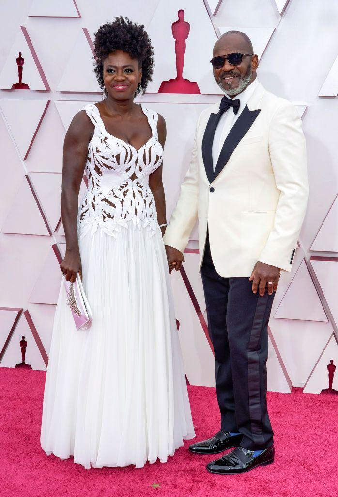 <p>Viola Davis, nominated for a Best Actress Oscar, paired with her husband Julius Tennon in white Alexander McQueen.</p>