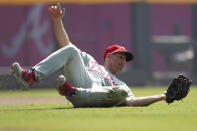 Philadelphia Phillies left fielder Brad Miller (33) catches a fly ball from Atlanta Braves' Adam Duvall in the first inning of a baseball game Thursday, Sept. 19, 2019, in Atlanta. (AP Photo/John Bazemore)