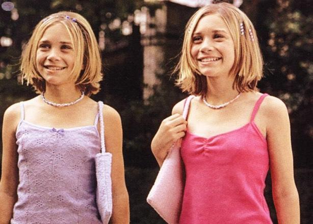 <p>Very matchy-matchy in tank tops, chokers, and purses in 'Passport to Paris'. (Photo: Dulastar Productions) </p>