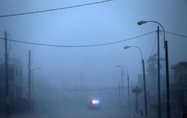 <p>A lone police car on patrol during the passing of Hurricane Irma on September 6, 2017 in Fajardo, Puerto Rico. (Photo: Jose Jimenez/Getty Images) </p>
