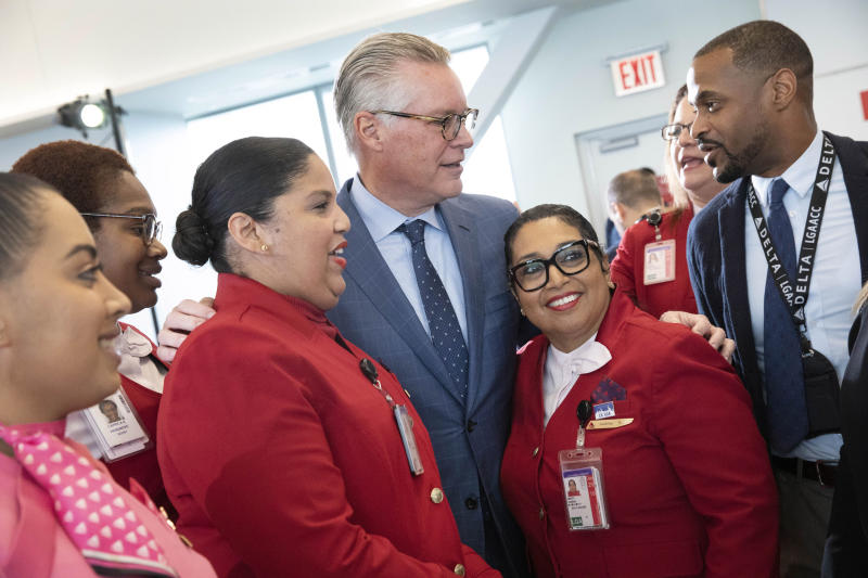 Delta Air Lines CEO Ed Bastian, center, meets with employees at the new $3.9 billion Terminal C at LaGuardia Airport, Tuesday, Oct. 29, 2019, in New York. Seven new gates will begin operating next Monday. The terminal will eventually have 37 gates across four concourses. (AP Photo/Mark Lennihan)