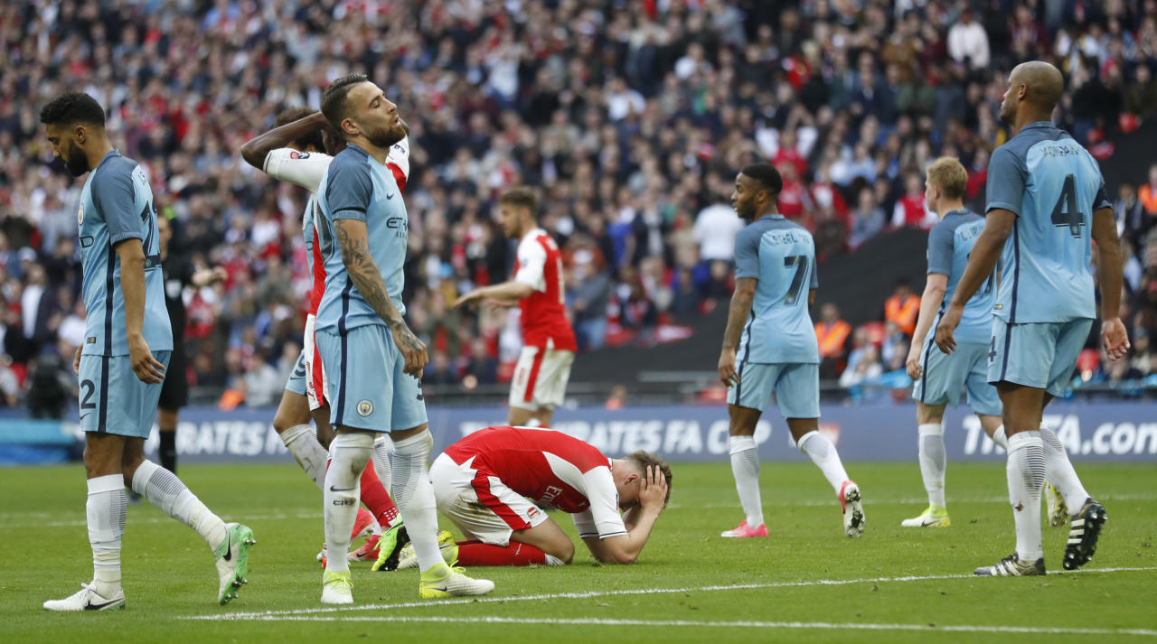 "Britain Football Soccer - Arsenal v Manchester City - FA Cup Semi Final - Wembley Stadium - 23/4/17 Arsenal's Rob Holding looks dejected after missing a chance to score Action Images via Reuters / Carl Recine Livepic EDITORIAL USE ONLY. No use with unauthorized audio, video, data, fixture lists, club/league logos or ""live"" services. Online in-match use limited to 45 images, no video emulation. No use in betting, games or single club/league/player publications.  Please contact your account representative for further details."