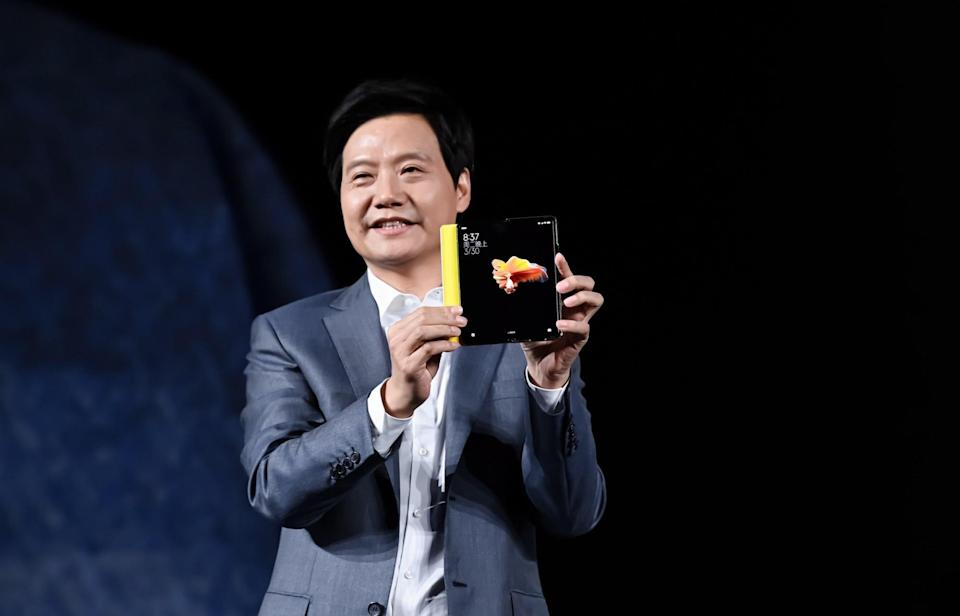 Xiaomi founder and CEO Lei Jun shows off the brand's new foldable smartphone Mi Mix Fold during a product unveiling event in Beijing, China, on 30 March 2021. Photo: Handout