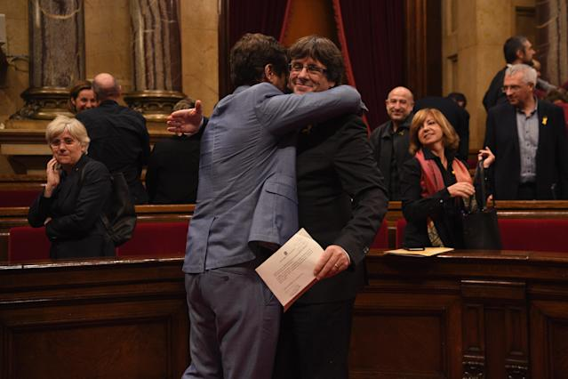 <p>Catalan President Carles Puigdemont (R) is hugged by Minister of Health Antoni Comín as they react to the news that the Catalan Parliament has voted in favour of independence from Spain at the Catalan Government building Generalitat de Catalunya on Oct. 27, 2017 in Barcelona, Spain. (Photo: David Ramos/Getty Images) </p>